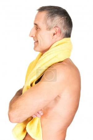 Photo for Side view mature man holding towel around neck. - Royalty Free Image