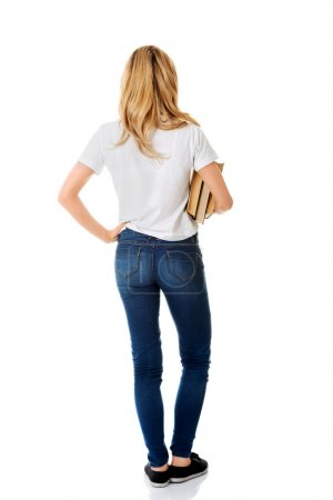 Photo for Blond woman standing holding a book, rear view isolated on white - Royalty Free Image
