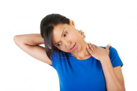 Photo for Young woman suffering from neck pain. - Royalty Free Image