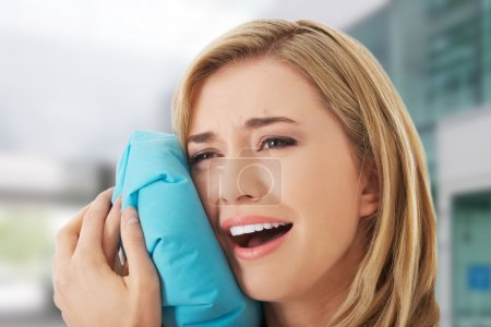 Woman having tooth ache