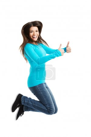 Side view happy woman jumping with thumbs up