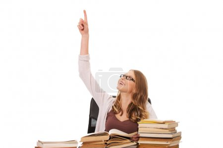 Photo for Happy teenage woman with stack of books pointing up - Royalty Free Image