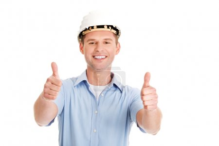 Photo for Portrait of a builder in a white helmet gesturing OK - Royalty Free Image