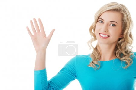 Woman waving to the camera