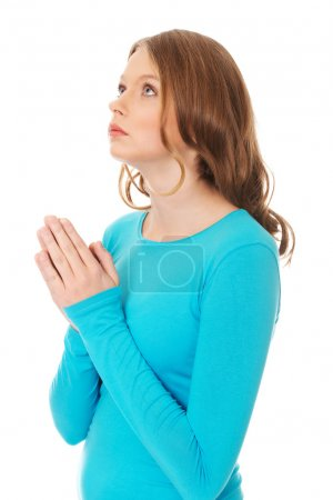 Woman praying holding clasp hands