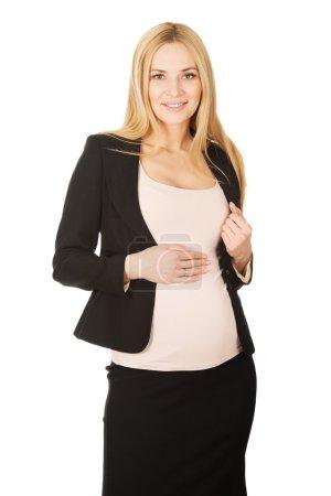 Pregnant woman in formal wear.