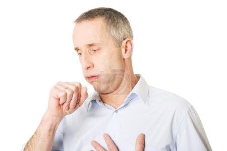 Man coughing because of flu