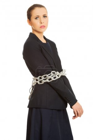 Businesswoman wrapped with chain.