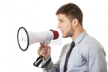 Photo for Handsome businessman shouting through megaphone. - Royalty Free Image