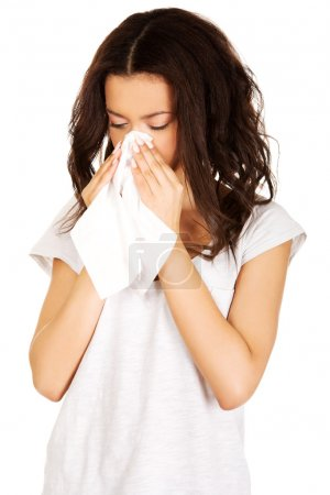 Photo for Young Unhealthy african teen sneezing to tissue. - Royalty Free Image