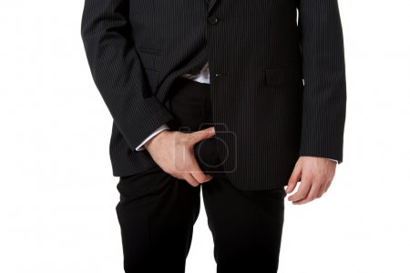 Young businessman feeling pain in his crotch.