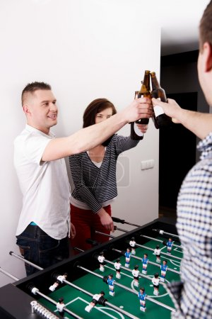 Friends playing table football.