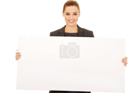 Photo for Happy business woman showing empty banner. - Royalty Free Image