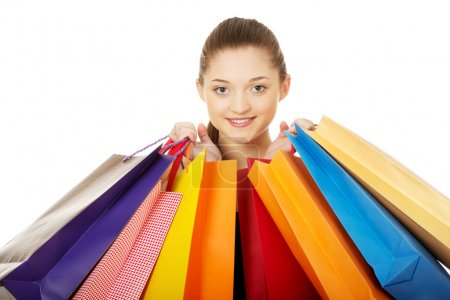 Photo for Young happy woman with shopping bags. - Royalty Free Image