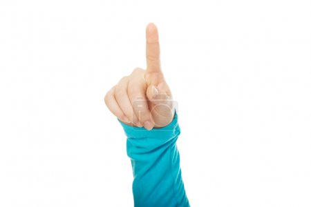 Photo for Caucasian womans finger pointing up. - Royalty Free Image