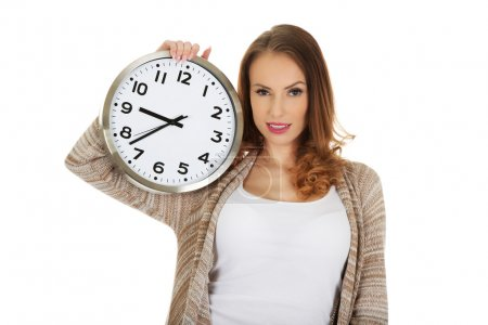 Happy woman with clock.