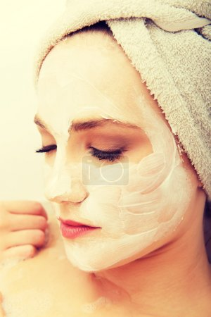Woman relaxing with face mask.