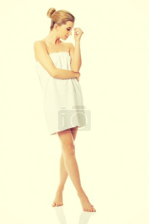 Spa woman wrapped in towel.
