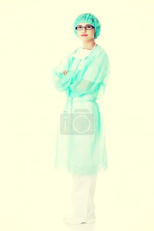 Photo for Full length female doctor with folded arms. - Royalty Free Image