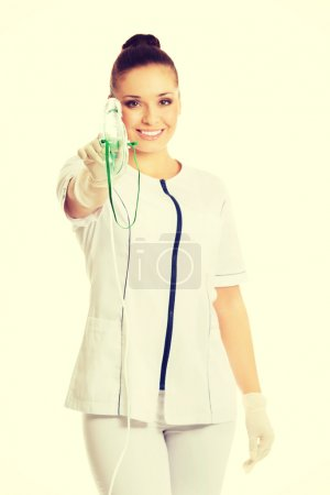 Female doctor holding up oxygen mask