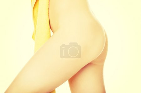 Photo for Female slim body covered by a towel. - Royalty Free Image