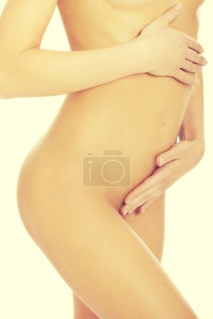 Attractive woman with her hands on her belly