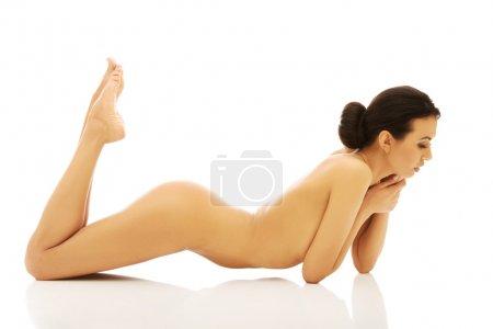 Photo for Slim nude woman lying on belly - Royalty Free Image