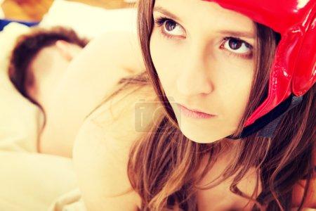 Afraid woman in protective helmet.