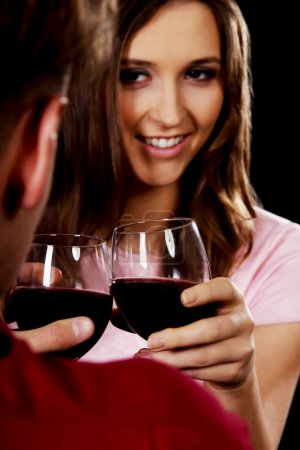 Photo for Couple on a date drinking wine. - Royalty Free Image
