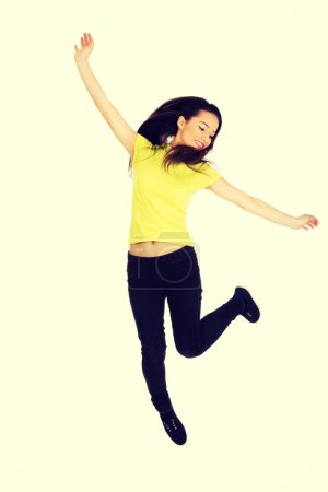 Photo for Young casual woman student jumping. - Royalty Free Image