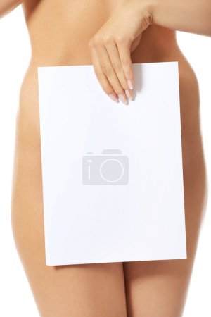 Photo for Young naked woman holding blank banner - Royalty Free Image