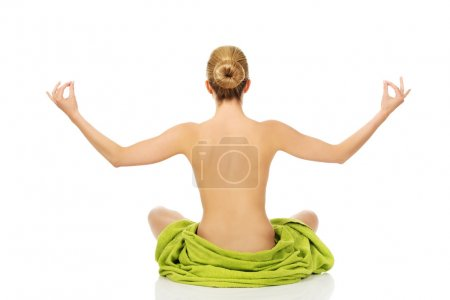 Young woman sitting in a yoga position