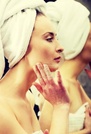 Woman take care of her face.