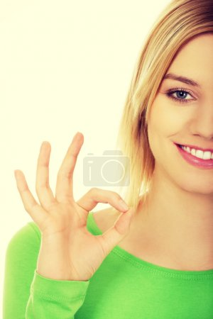 Woman showing perfect sign.