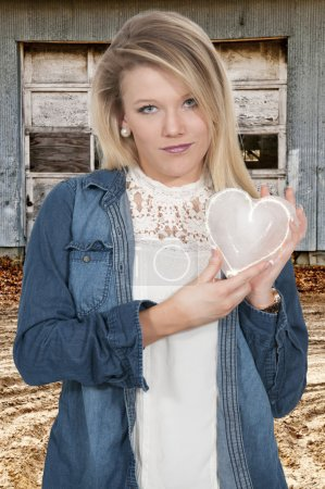 Photo for Woman holding a heart made of ice - Royalty Free Image