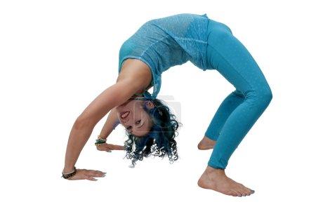 Beautiful woman practicing a back bend yoga positi...
