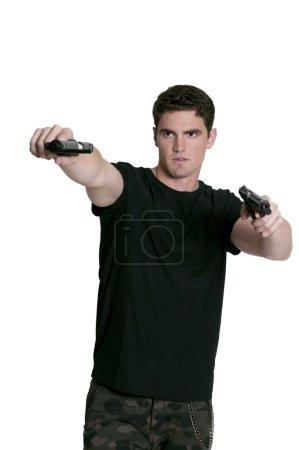 Photo pour Homme de beau gangster tenant un couple de pistolets - image libre de droit