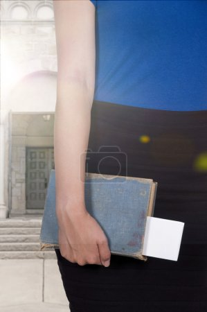 Photo for Beautiful woman holding a library book - Royalty Free Image