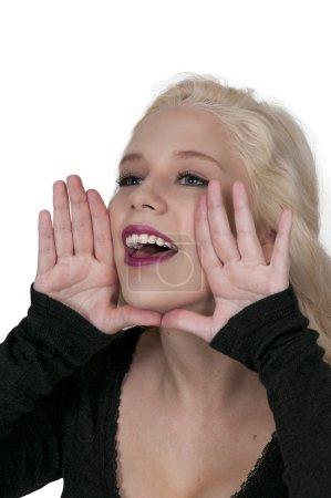 Young beautiful woman yelling