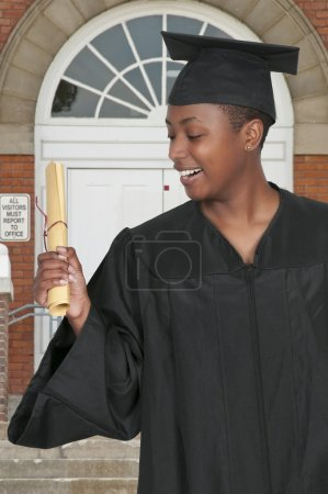 Photo for Young black african American woman in her graduation robes - Royalty Free Image