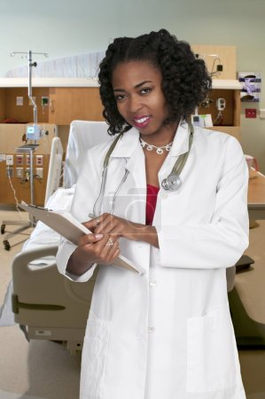 Black Woman Doctor with patient records