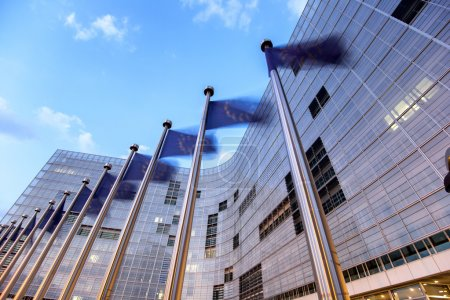 Photo for Waving flags of European Union in front of European Comission building in Brussels - Royalty Free Image