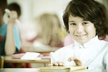 Children at classroom having school lesson