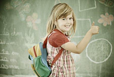 Little girl at school having education activities
