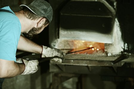 Working on iron stove factory