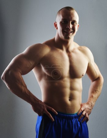 Body builder posing in studio