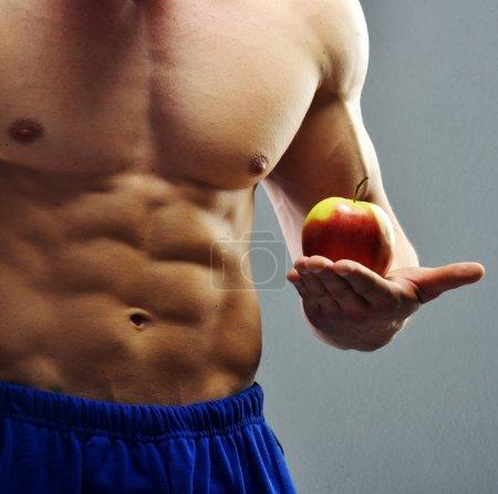 Muscular handsome bodybuilder posing in studio