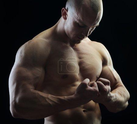 Body builder posing in studio
