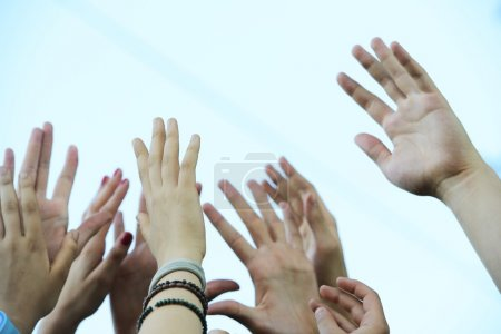 Group raising hands