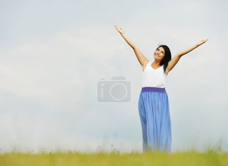 Young person having relaxed happy time on meadow in nature